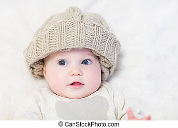 Sweet baby in a brown knitted hat