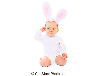 Sweet baby in easter bunny ears on a white background