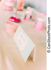 Sweet Bar Paper Sign on Wedding Table with Coloured Sweets