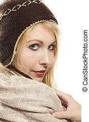sweet beautiful blonde woman wearing winter fashion on white background