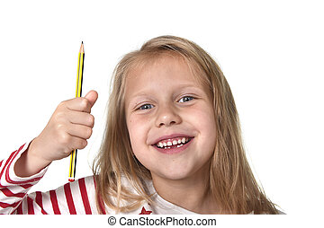 sweet beautiful female child 6 to 8 years old holding pencil school supplies concept