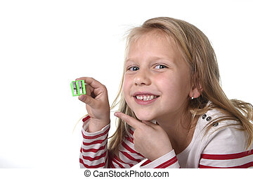 sweet beautiful female child with blue eyes holding drawing pencil sharpener school supplies