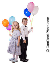 Sweet boy and girl with colorful balloons