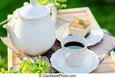 Sweet breakfast - a cup of coffee with cake