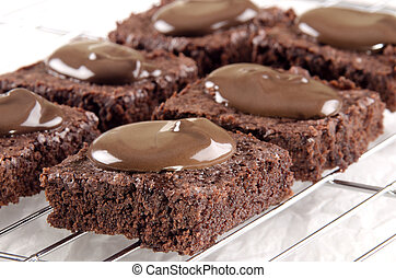 brownie baked with chocolate on a cooling rack