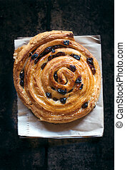 Sweet bun with dried grapes