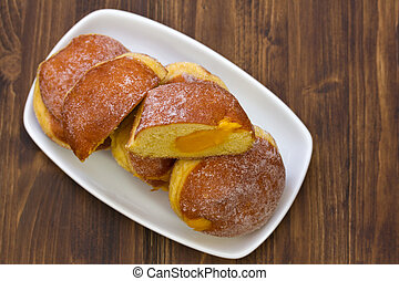 sweet buns with cream on white dish