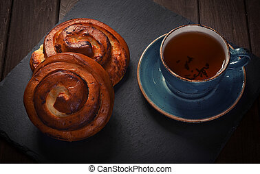 sweet buns with cup of tea
