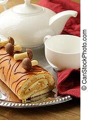 Sweet cake roll with coffee cream