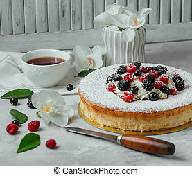 sweet cake with berries on the table