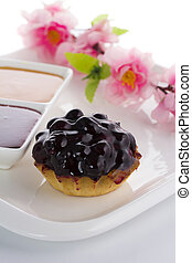 Sweet cake with cherry isolated on a white plate