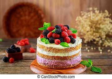 Sweet cake with fresh berries on the top.