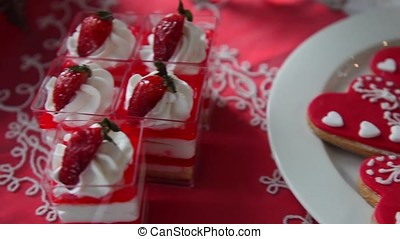 Sweet cake with strawberries and cookies in the form of a heart.