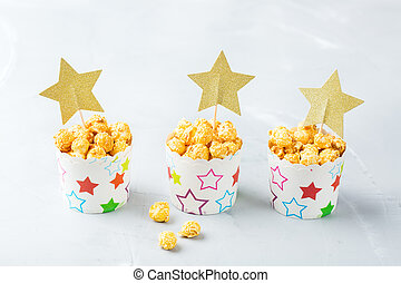 Sweet caramel popcorn for party holidays or cinema at home