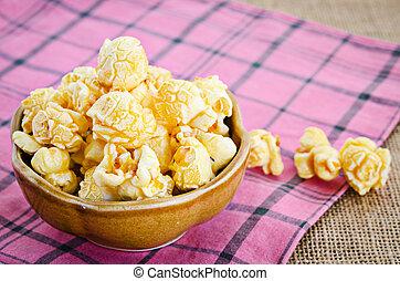 Sweet caramel popcorn in a bowl.