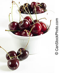 Sweet cherries - Freshly picked heap of cherries in bowl.
