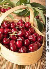 Sweet cherries in a wooden basket.