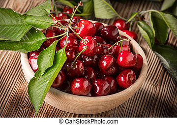 Sweet cherries in a wooden bowl.