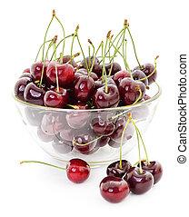 Sweet cherries in vase.