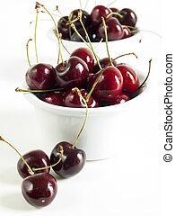Sweet cherries - Freshly picked heap of cherries in bowl.