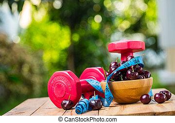 Sweet cherries on the table in garden.
