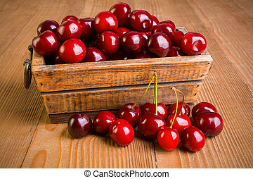 Sweet cherry berries (Prunus avium) in wooden box
