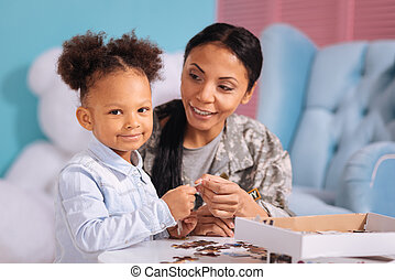 Sweet child and her mom enjoying every moment together