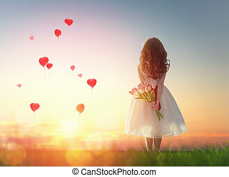 girl looking at red balloons - Sweet child girl looking at...