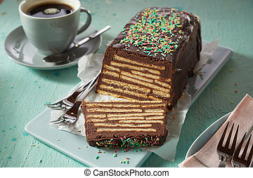 Sweet chocolate cake with biscuits and topping