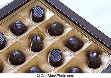 Sweet chocolate candies assortment in a box close-up. Top view