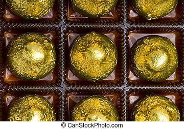 sweet chocolate candy in box macro
