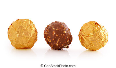 Sweet chocolate candy wrapped in golden foil isolated on...