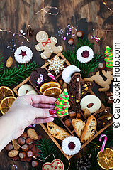 Sweet Christmas cookies in wooden box on rustic table