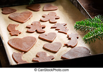 Sweet Christmas gingerbread cookies on baking tray
