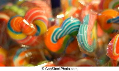 Sweet colored lollipops. Night market, Pattaya, Jomtien....