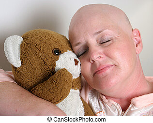 Sweet Comfort - A medical patient cuddling with a teddy bear...