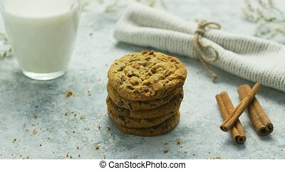 Sweet cookies and glass of milk - Composed stack of...