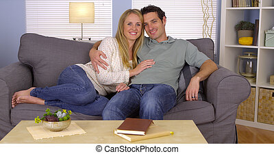 Sweet couple cuddling on couch