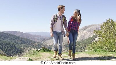 Sweet couple on summit of mountain - Young loving couple...