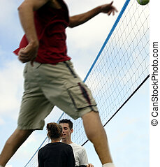 Sweet couple - Young people talking during volleyball game....