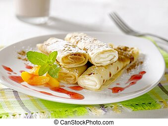 Sweet crepes and cocoa - Rolled up crepes filled with sweet ...