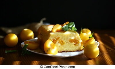 sweet curd casserole stuffed with yellow plums inside on a...