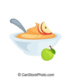 Sweet delicious applesauce in deep bowl with spoon. Puree...