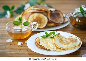 sweet delicious pancakes with tea for breakfast