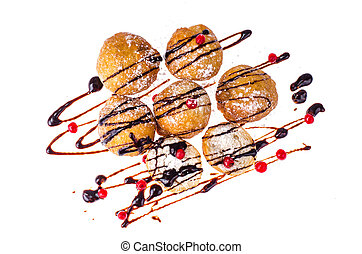 Sweet donuts with chocolate topping on white background