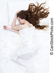Sweet dream - Image of peaceful girl lying on linen bed...
