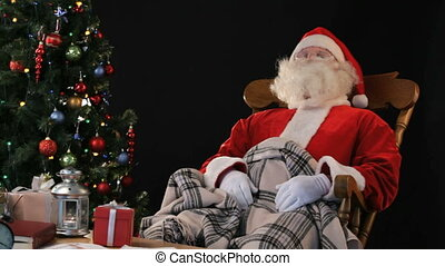 Sweet dreams - Santa Claus relaxing in a rocking chair...