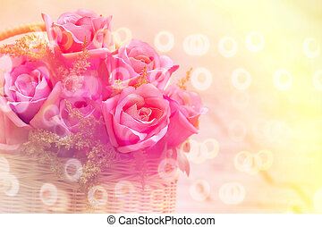 bouquet of pink rose in bamboo basket