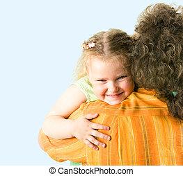 Sweet embrace - Image of loving little girl hugging her...