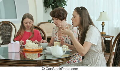 Sweet family life - Grandmother and granddaughters enjoying...